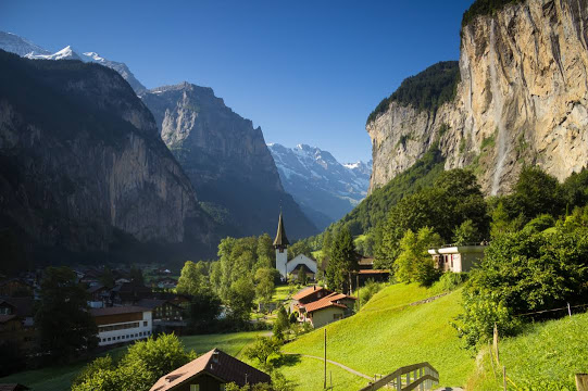 Waterfalls, Snow-capped mountains, Verdant hills